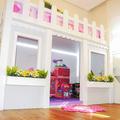 Casa de Boneca no quarto da filha no apartamento na Aclimação.