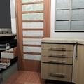 Cozinha com gabinete para pia e gavetões aramados.
