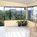 Fechamento em vidro, janelas e portas.