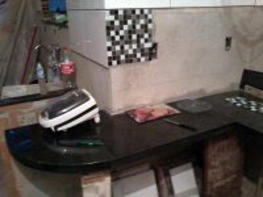 colocação de pastilhas de vidro, cerâmicas, bancada granito