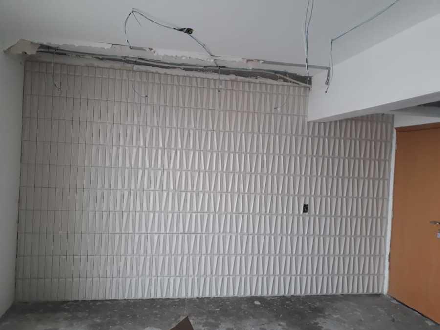 Colocação  de  revestimento  parede  3d