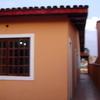 Reboco de paredes externas em casa térrea