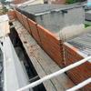 Construção de muro de 110 metros lineares x 3 metros de altura