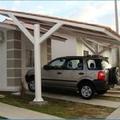 Coberta de garagem em condomínio fechado.
