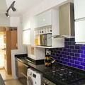 Cozinha integrada à varanda gourmet