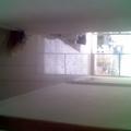 vista do corredor da cozinha para sala