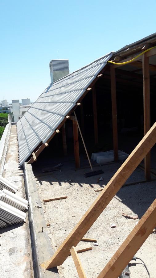 Troca de madeira e reposição de telha