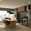 Área gourmet integrada com a sala de estar e cozinha.