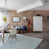 Sala de Estar integrada a Sala de Jantar Modernas e Contemporâneas com parede de tijolinhos