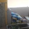 Construção em alvenaria de fogão à lenha com forno